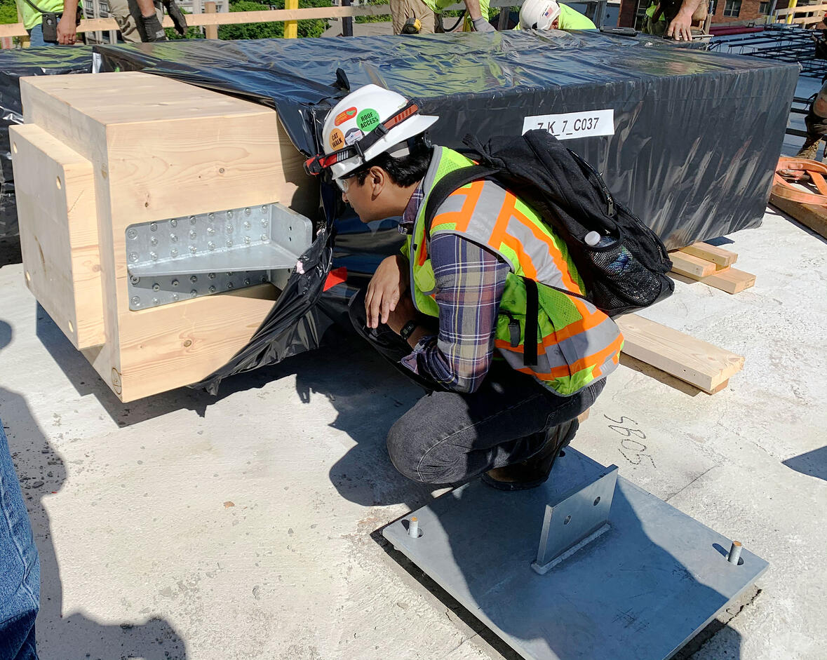 C.D. Smith Construction Worker inspects column for building Ascent MKE tallest mass timber tower