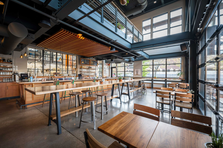 La Crosse Distillery modern industrial interior bar & indoor outdoor dining built by C.D. Smith Construction Manager