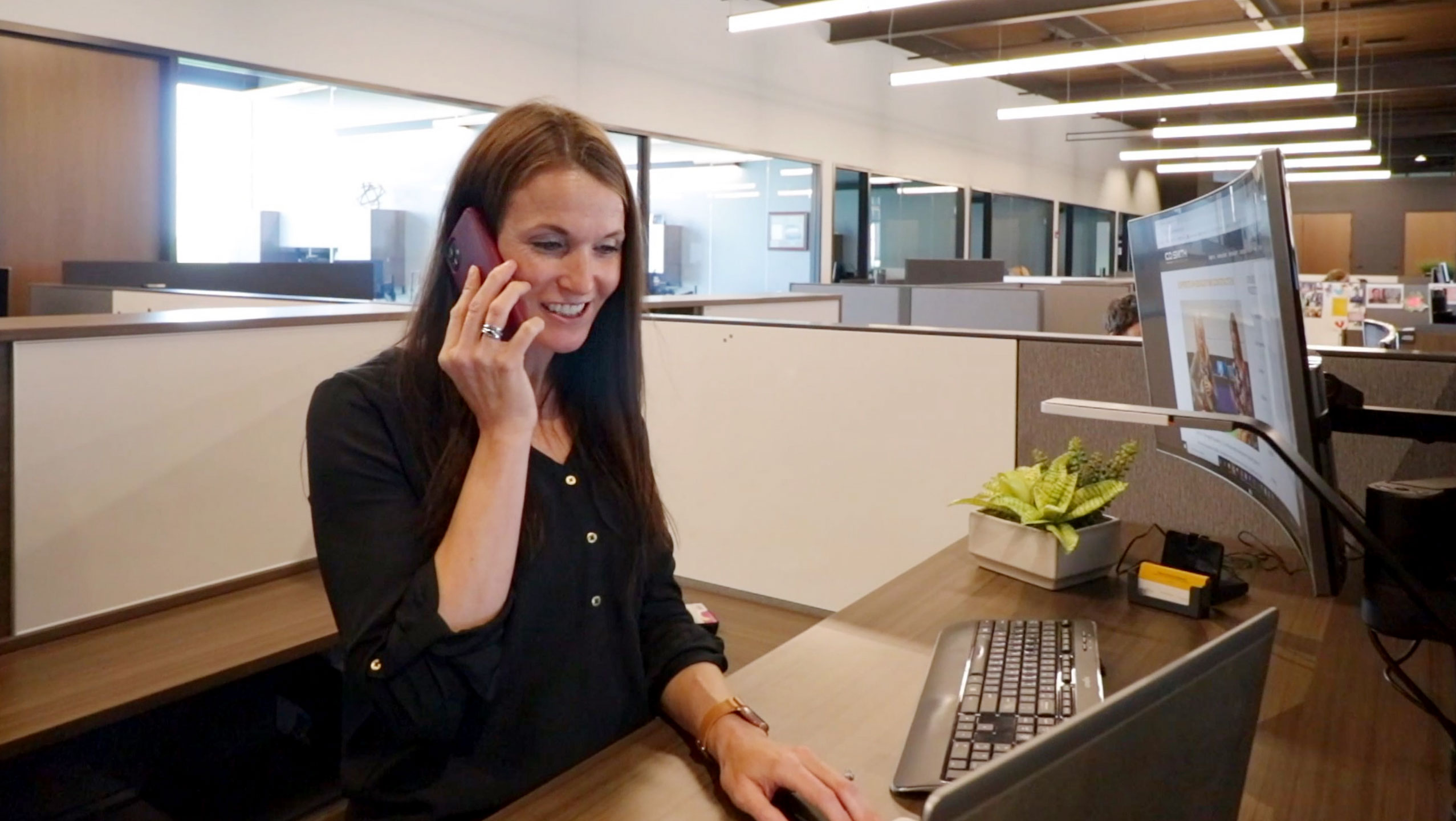 C.D. Smith Construction Director of Educational Markets Tricia Muellenbach on the phone