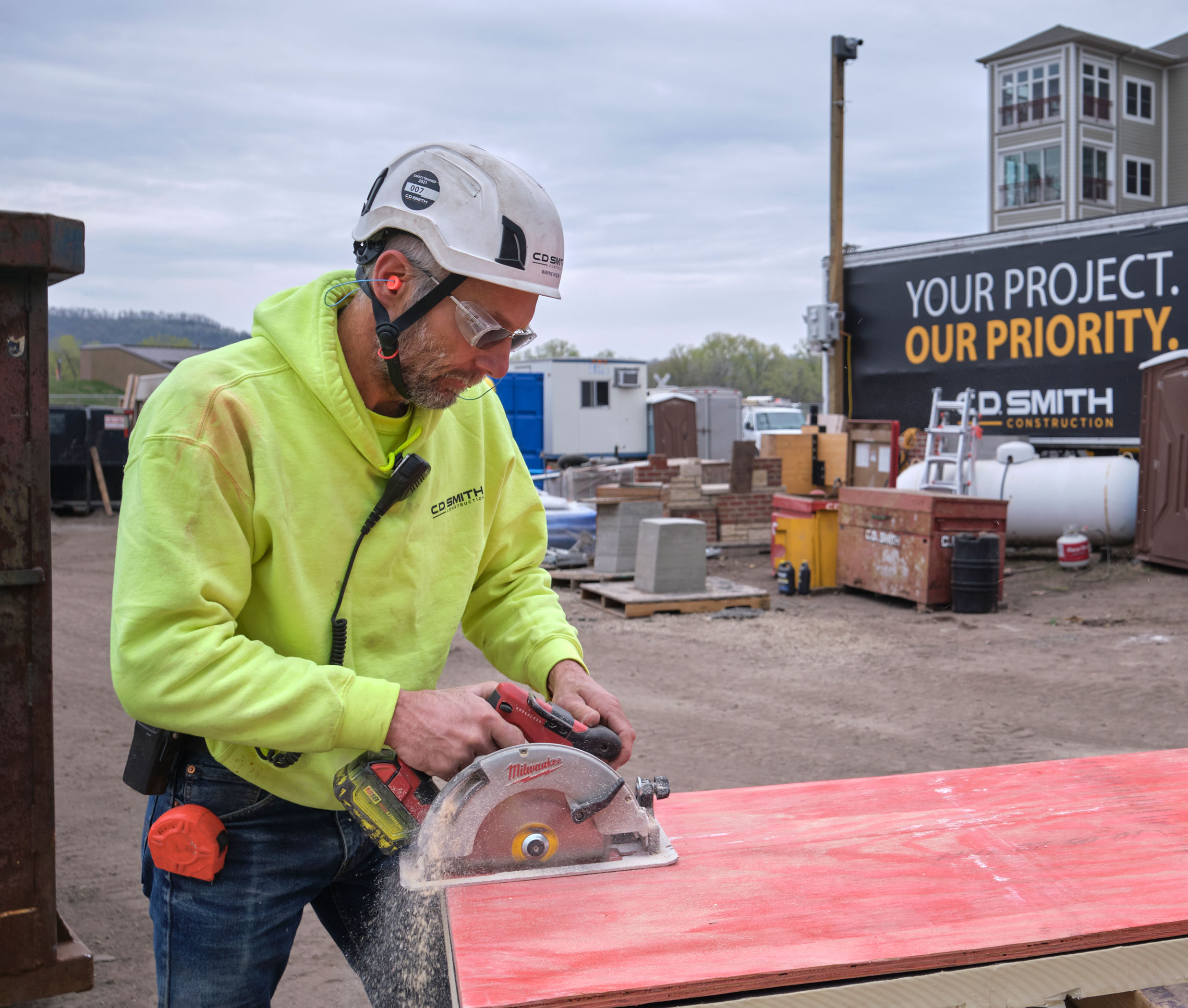 C.D. Smith Construction Superintendent Wayne Holum working in the field on a commercial project jobsite