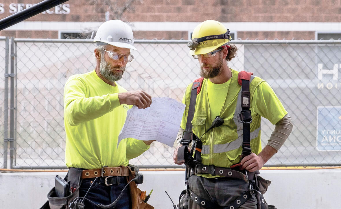 C.D. Smith Construction superintendent Wayne Holum on a jobsite looking over drawings