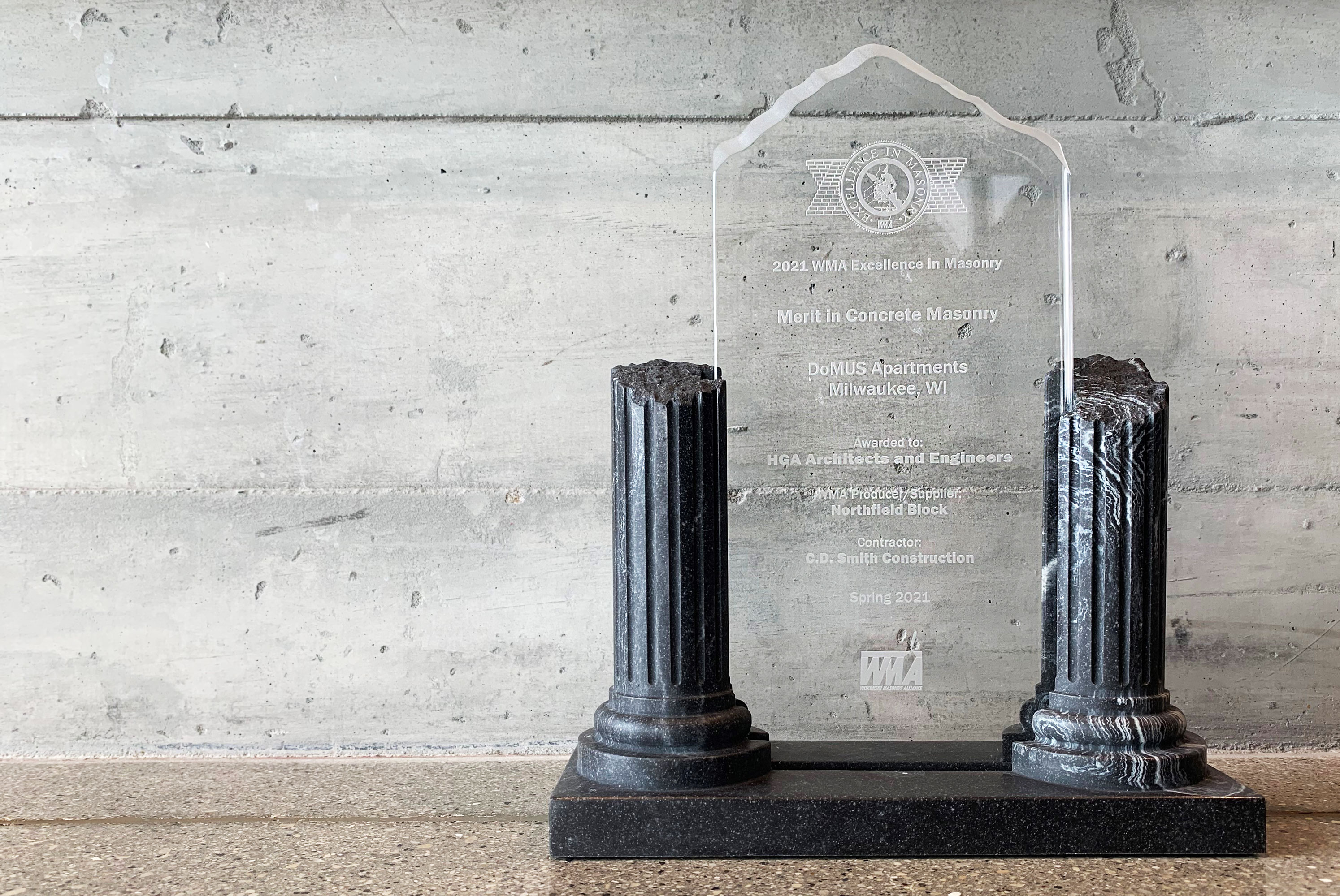 Picture of Merit in Concrete Masonry Award from the Wisconsin Masonry Alliance for DoMUS Apartments Construction Project