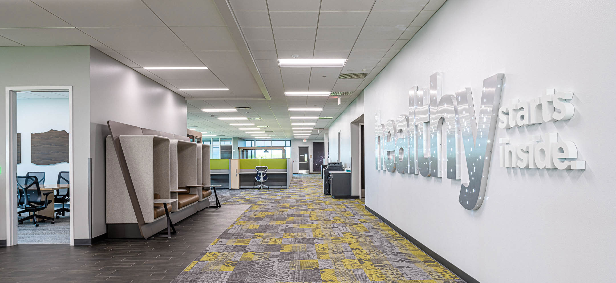 Workspace cubby hallway company culture wall art of Nature's Way new corporate office facility constructed by C.D. Smith Construction firm