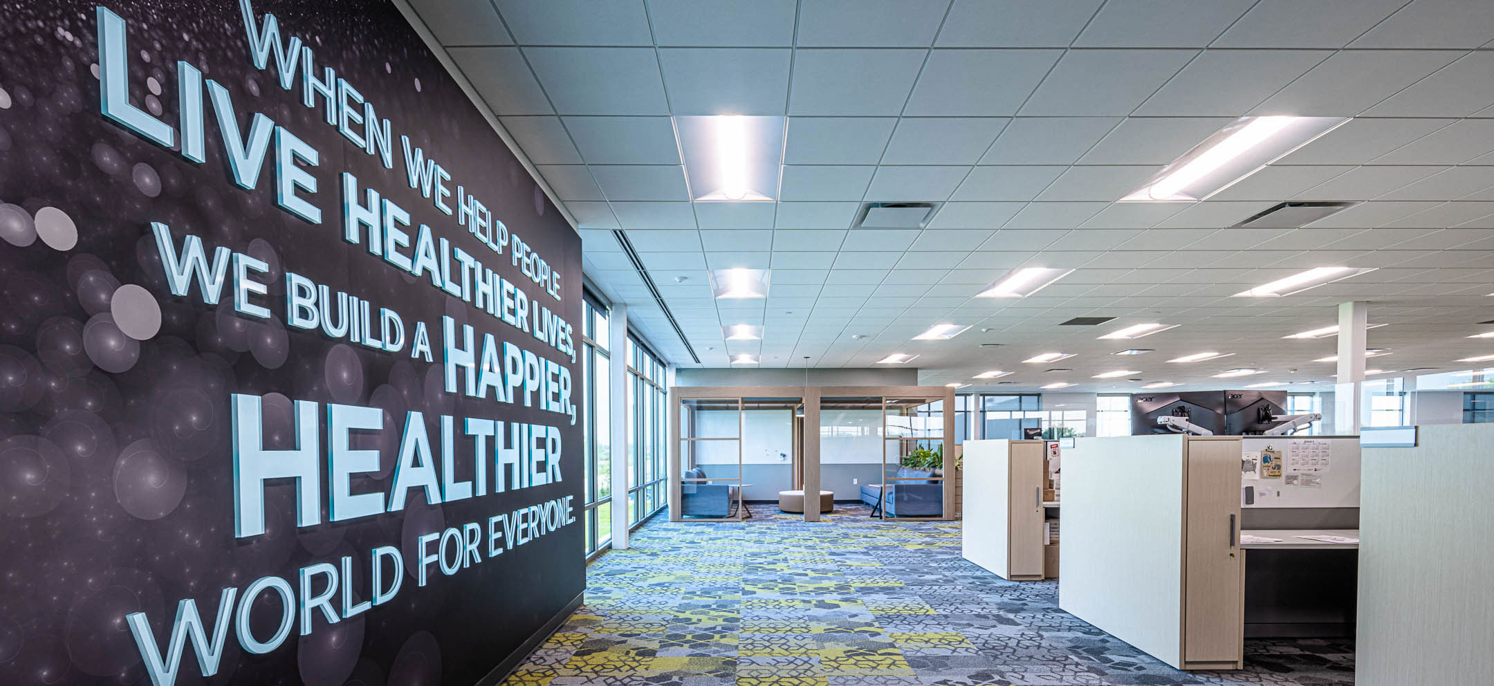 Workspace & culture wall art of Nature's Way new corporate office facility constructed by C.D. Smith Construction firm
