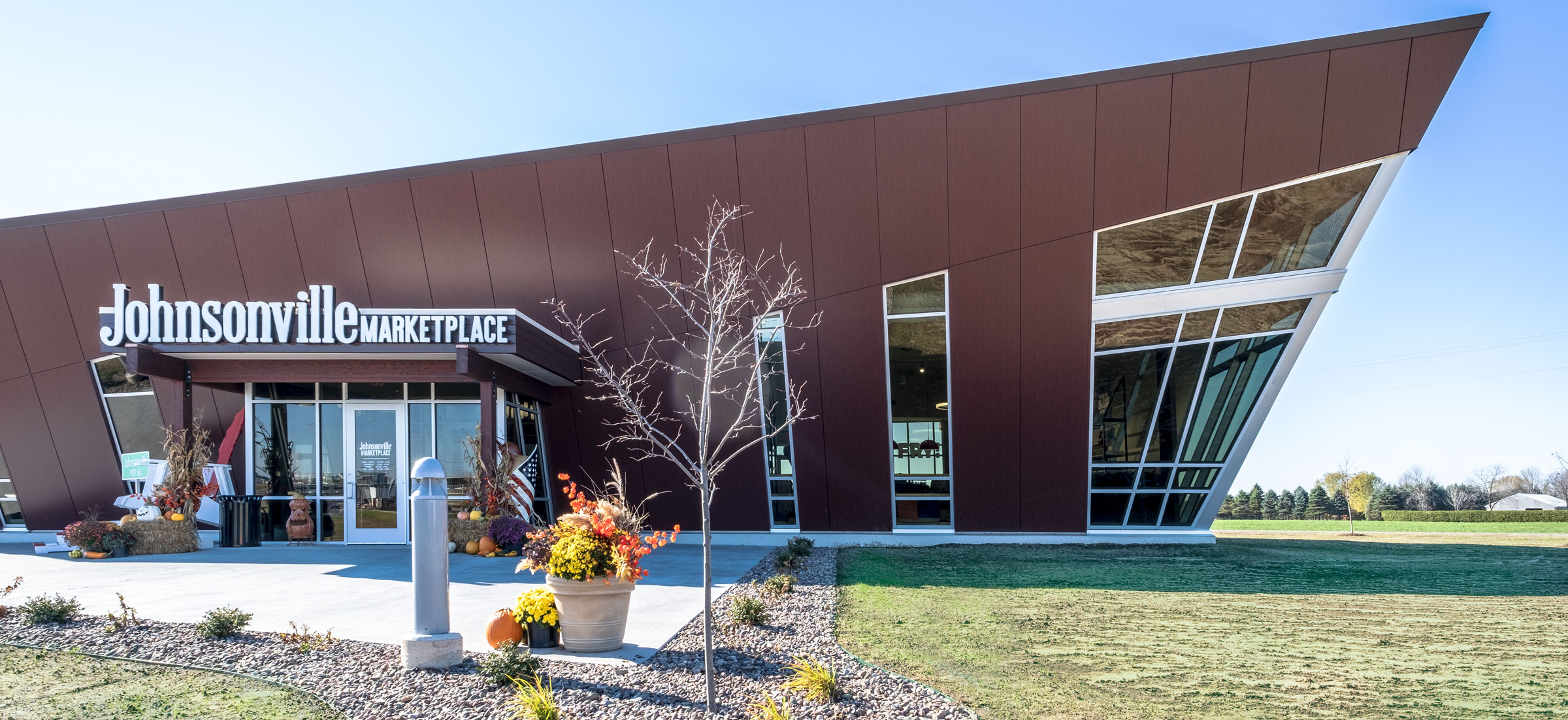 Johnsonville Marketplace Retail Shop Modern Exterior Canted Facade Green Build by C.D. Smith Construction Manager