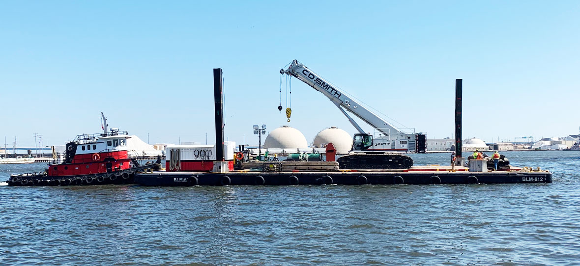 Telescopic Crawler Crane Custom Built & Delivered by Barge for C.D. Smith Construction Fleet Heavy Equipment Operators.